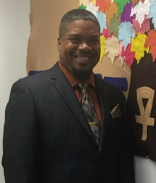 A picture of our Executive Director/CEO, Jerry C. Dillard, smiling while wearing a suit in our office.